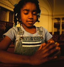 Child Praying at Church